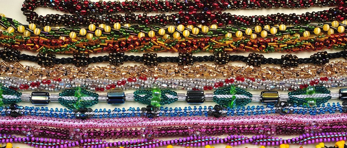 different Kumihmio chains with a lots of different glass beads