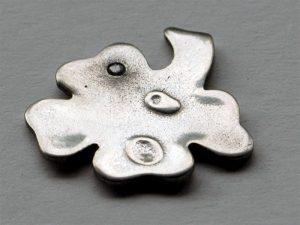 Kleeblatt aus Prometheus Bronze nach dem Polieren - aber mit Fehler